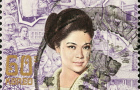 A stamp emblazoned with the face of former first lady Imelda Marcos