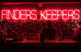 A neon sign spells out Finders Keepers